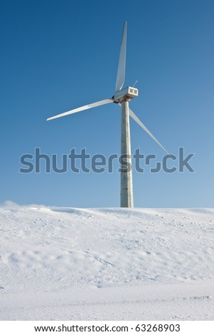 Old windmill in snowy landscape of the Netherlands