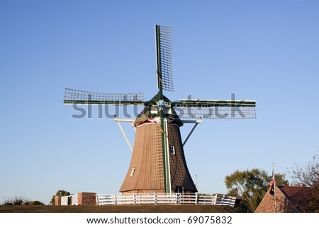 Old windmill in the light of the setting sun.