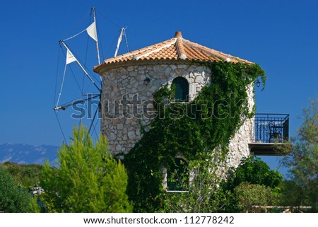 Old windmill under the clear blue sky, Cape Skinari, Zakynthos, Greece