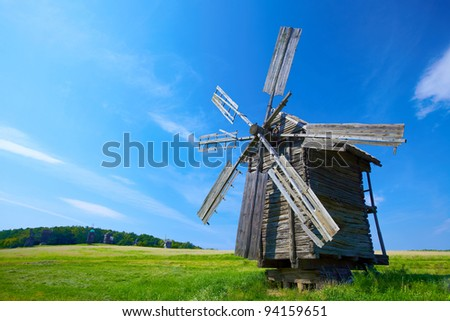 old windmill with blue sky