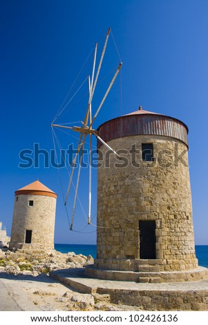Old windmills in Mandraki harbor, Rhodes, Greece