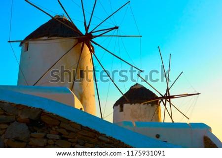 Old windmills in Mykonos island at sundown, Greece