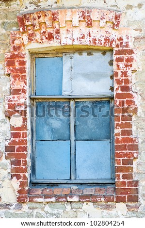 Old window and old brick wall