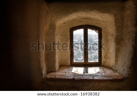 Old window from interior of a medieval castle