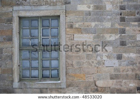 old window in a wall - stock photo