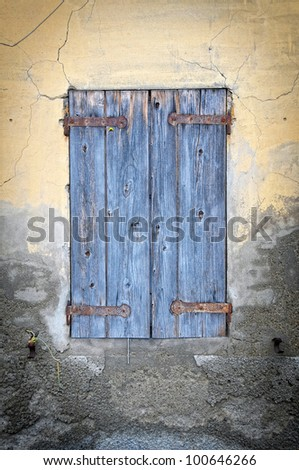 Old window in an abandoned house - stock photo