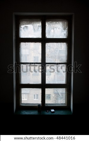 Old window in the entrance of an apartment house