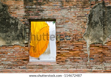old window in the old red brick wall texture in horizontal view at Ayutthaya, Thailand