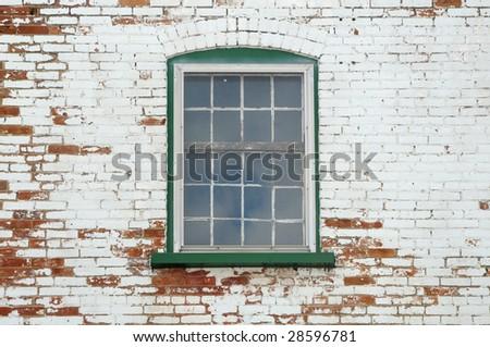 Old window on a brick wall