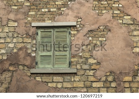 Old window on the brick wall