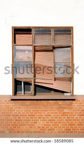 Old window with broken shutter