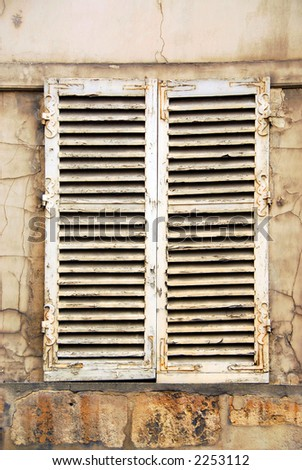 Old window with shatters in Paris France