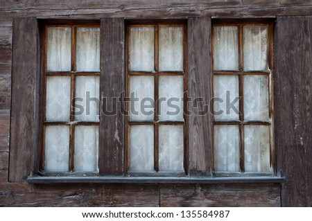 Old Windows in Wooden Frame from a traditional Swiss Chalet