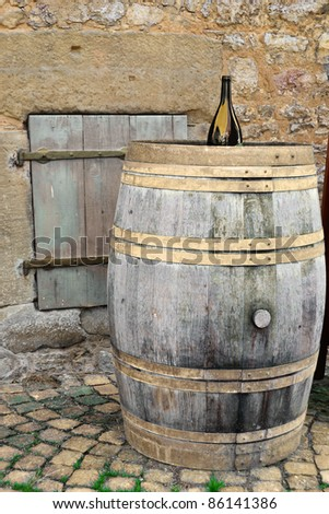old wine barrel with various textured background objects