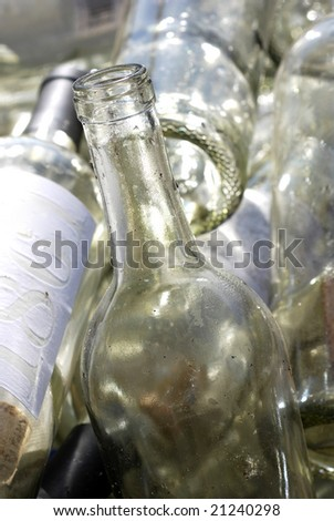 Old wine bottles in a recycling bin at a winery