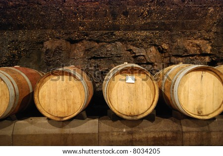 Old wine cave with wooden barrels