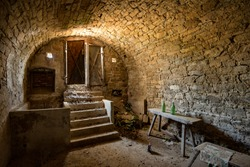 Old wine cellar in Austria with old table and wine bottles and stairs, wine yards