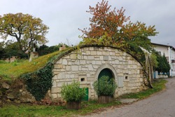 Old wine cellar with round roof like hobbit house, Austria