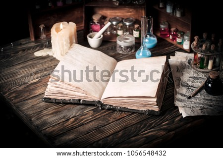 Old witch book with empty pages, lavender flowers, pentagram and witchcraft objects #1056548432