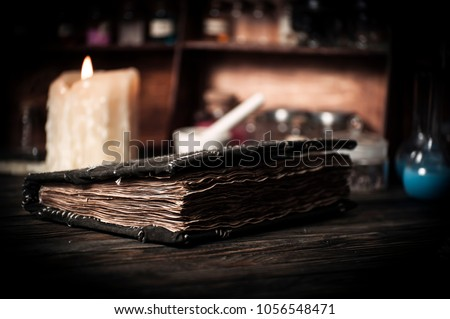 Old witch book with empty pages, lavender flowers, pentagram and witchcraft objects #1056548471