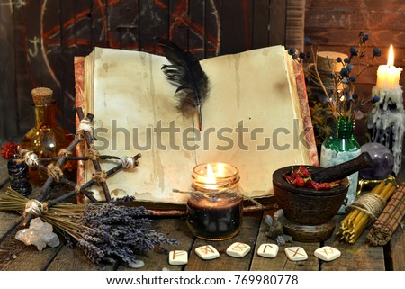Old witch book with empty pages, lavender flowers, pentagram and witchcraft objects. Occult, esoteric, divination and wicca concept. Mystic and vintage background  #769980778