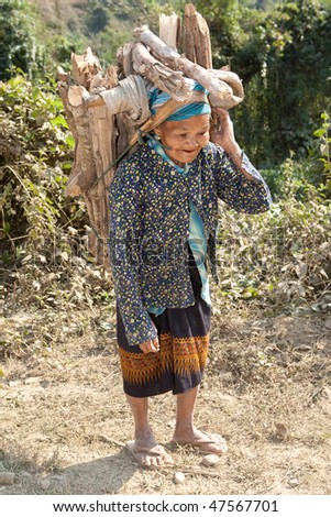 old woman Asia carry firewood