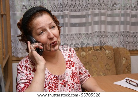old woman calling by phone