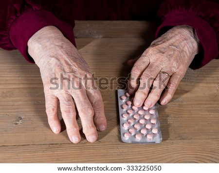 Old woman going to take the medicine at home