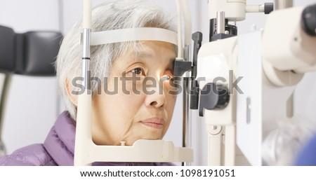 Old woman having her eyes examine