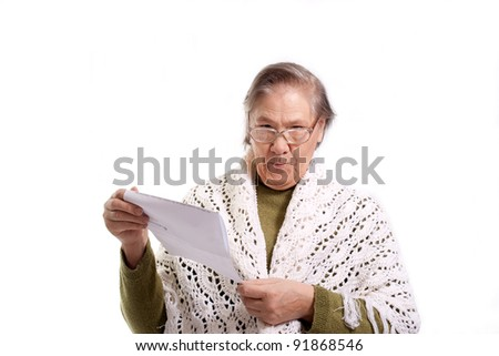 old woman holds a letter or a bill