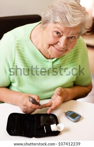 old woman in blood sugar measure