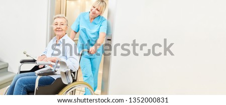 Old woman in wheelchair with walking aids is being cared for by a nurse