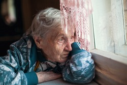 Old woman is sad emotions the home.