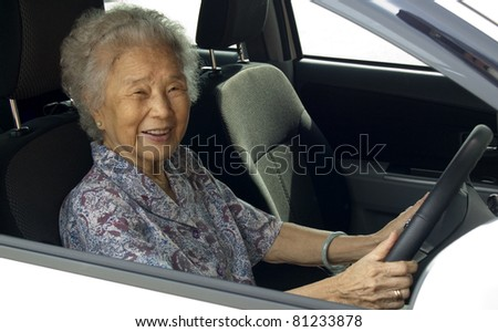 Old woman knows to drive the car.