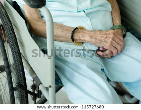 old woman on a wheelchair.