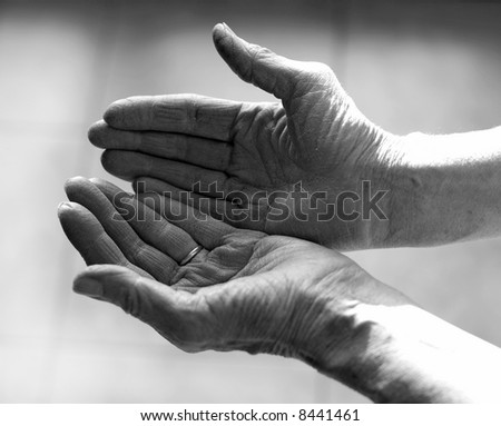 Old woman palm open up as a gesture of peace and giving thanks - stock photo
