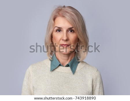 old woman portrait isolated on grey background