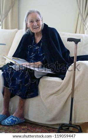 old woman reads book