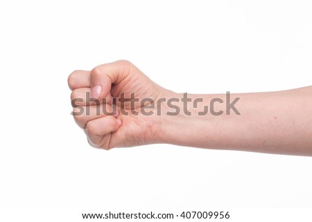 Old woman's fist with perfect manicure over white background. Nice fist of old lady in studio. #407009956