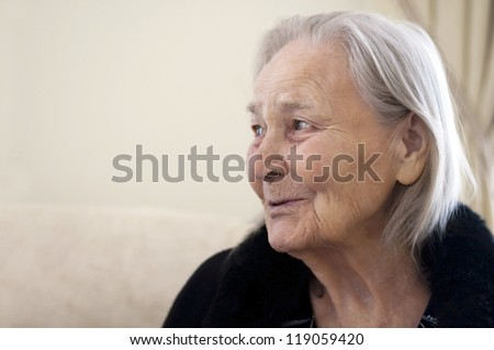 old woman speaks with somebody