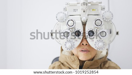 Old Woman undergo eye test in clinic