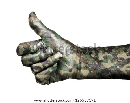 Old woman with arthritis giving the thumbs up sign, isolated on white, camouflage