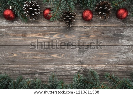 Old wood background with fir branches adorned with baubles and cones. Space for text. Christmas card. Top view. Xmas. #1210611388