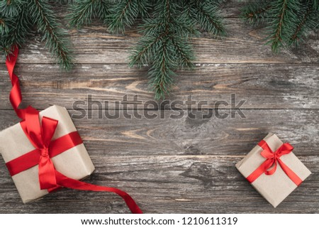 Old wood background with fir branches. Holiday Gifts. Christmas card. Top view.