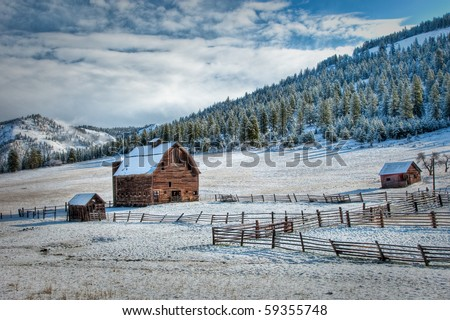 Old wood barn with spring snow and interesting clouds