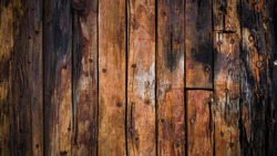 old wood boards on the deck and the hull of the ship