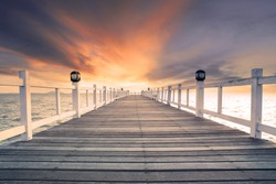 old wood bridge pier with nobody against beautiful dusky sky use for natural background ,backdrop and multipurpose sea scene