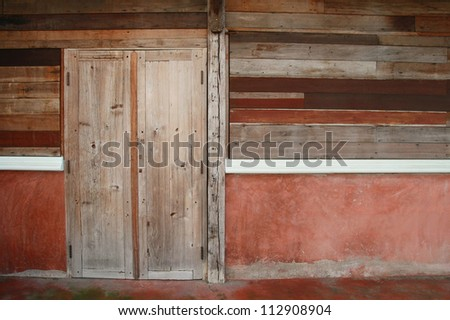 old wood door and plank wall