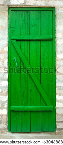 Old wood door painted with green color