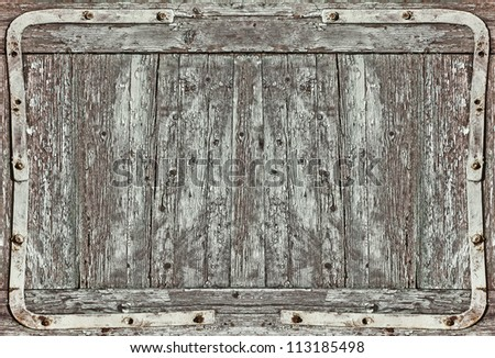old wood door with metal frames, wood plank background
